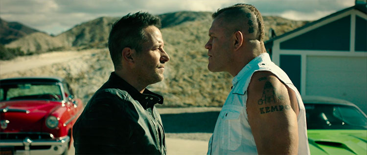A tense exchange between Frank (Johnny Messner) and Nelson (Chuck Liddell).